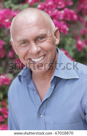 Man smiling in an outdoors garden setting