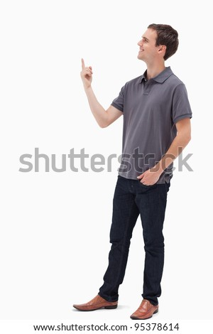 Man smiling while standing and presenting something above against white background