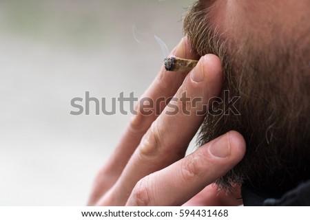 Man smoking cigarette #594431468