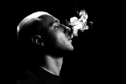 Man Smoking on black background