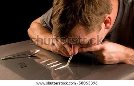 man snorting cocaine