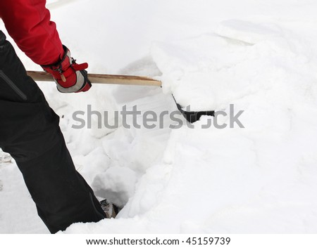 Man snow cleaning by a shovel