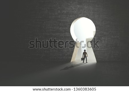 Man solving problem to have the key access to success, surreal concept