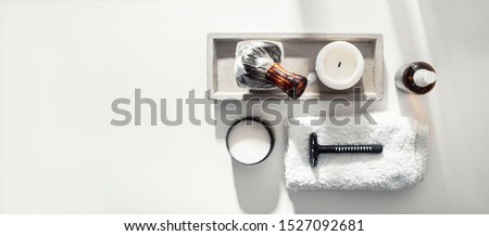 Man spa accessories to shaving and grooming lying on a clean white background, flat lay, top view