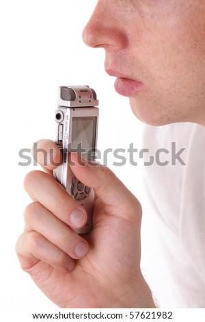 Man speak in dictaphone. Closeup