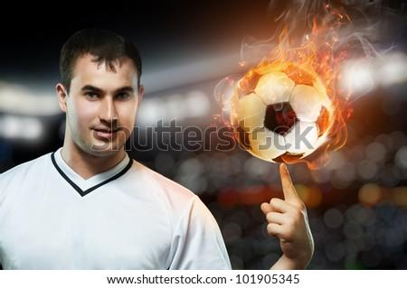 man spinning ball on finger
