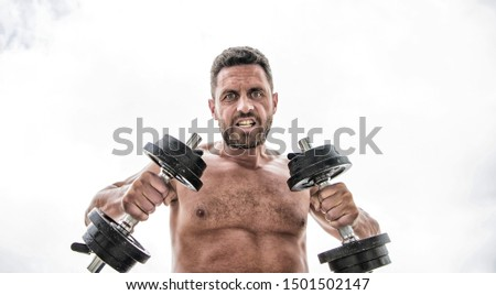 man sportsman with strong ab torso. steroids. athletic body. Dumbbell gym. fitness health diet. Muscular angry man exercising with barbell. sport equipment. Perfect six pack. Sport is our life.