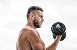 man sportsman with strong hands. steroids. athletic body. Dumbbell gym. fitness and sport. Muscular man exercising in morning with barbell. success. Perfect biceps. Keeping those muscles flexible.