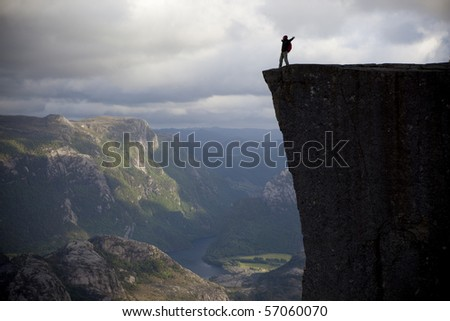Man stand on the rock.