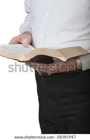 Man standing and holding open Bible. Close up.