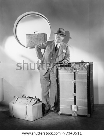 Man standing and waiting with his luggage