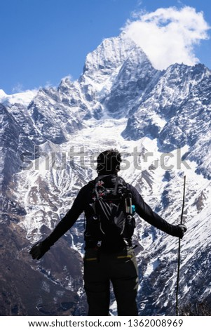 Man standing in front of a majestic majestic on the trek to Everest, Nepal #1362008969