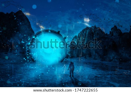 Man standing in front of dimensional gate. Futuristic landscape at night. Mountains at background. Photo stock ©
