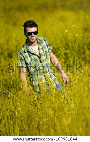 Man standing in green field