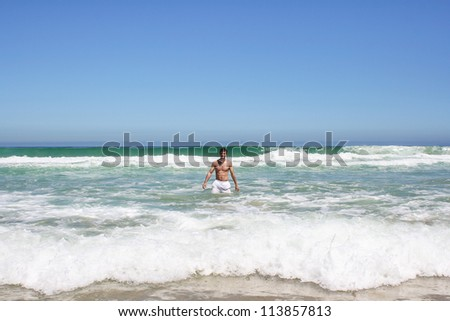 Man standing in indian ocean in south africa