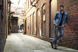 Man standing in street wearing denim, portrait