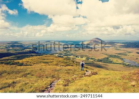 man standing in the connemara...