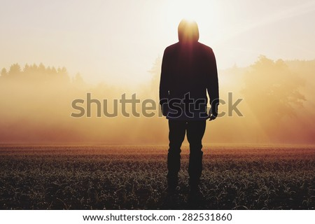 Man standing in the fog at sunrise #282531860