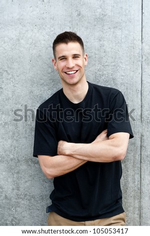 man standing near the wall - stock photo
