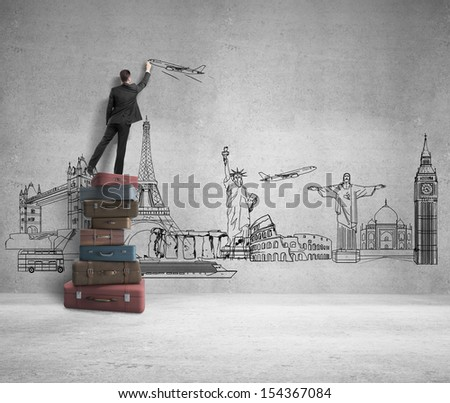 man standing on bags and drawing traveling concept