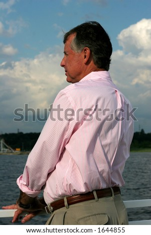 man standing on boat