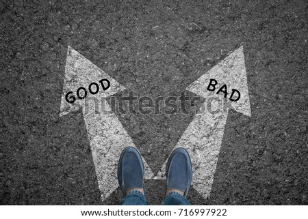 man standing on road with direction arrow choices Good and Bad or move forward. concept solution and start.