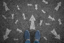 man standing on road with many direction arrow choices or move forward. concept solution and start.