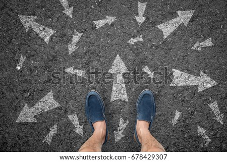 man standing on road with many direction arrow choices or move forward. concept solution and start. #678429307