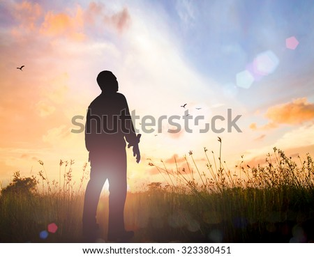 Man standing on sunset background. World Mental Health Day Mercy Evangelism Right Freedom Faith Trust Catholic Hope Meditation Migrant Free Bold Labor Labour May Law God Power Moral Grief concept