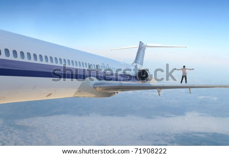 Man standing on the wing of an airplane