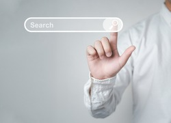 Man standing with hands pointing to information search is a data clicking to virtual internet search page computer touch screen. Education, Knowledge, Analysis the Internet to connect wirelessly.