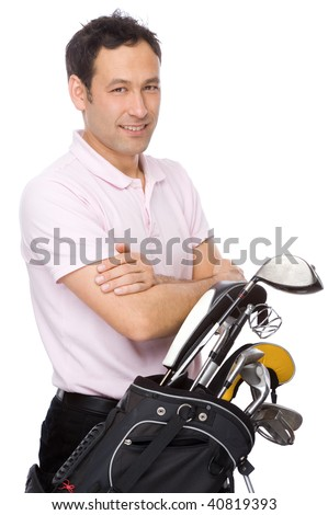 Man standing with his arms crossed near his golf kit