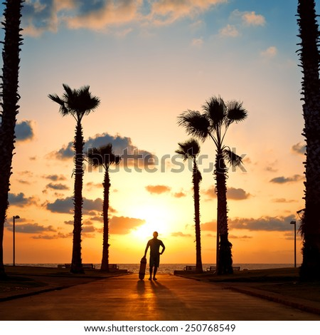 man standing with skateboard on sunset #250768549