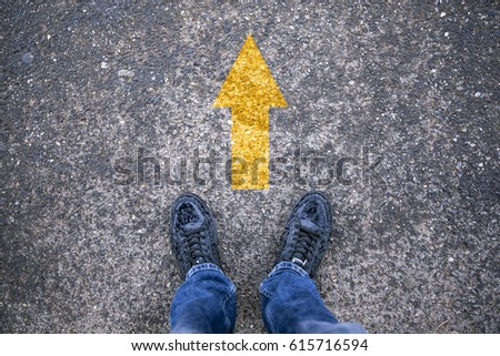 Man standing with yellow arrow move forward for the future