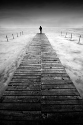 Man stands on a pier