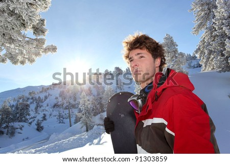 Man stood with snowboard