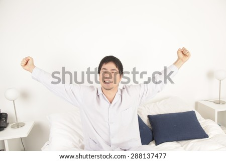Man stretching after wake up - Shutterstock ID 288137477