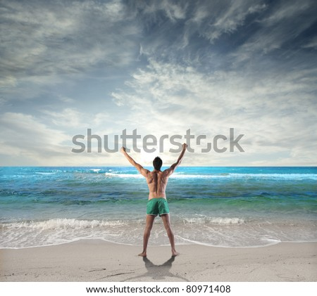 Man stretching at the seaside