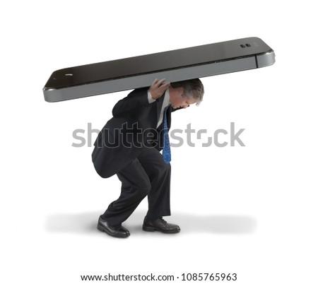 Man struggling to carry huge cell smartphone representing social media communication burnout constantly connected to everyone, mass media, online content, hypermedia, fake news political propaganda.