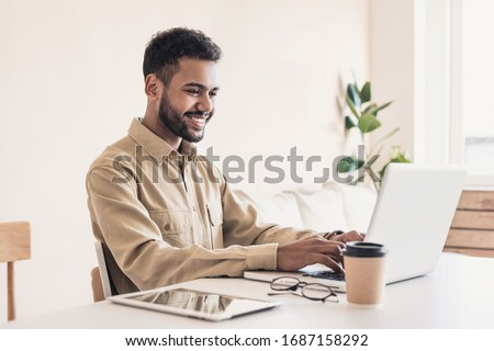 Man student working on computer. Businessman using laptop at home. Internet marketing, freelance work, working from home, online learning, studying, lockdown concept. Distance education