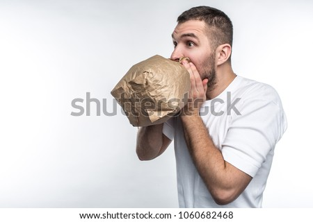Man suffering from a stress attack. He is trying to come calm down. Isolated on white background.