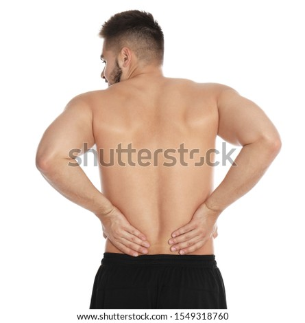 Man suffering from backache on white background