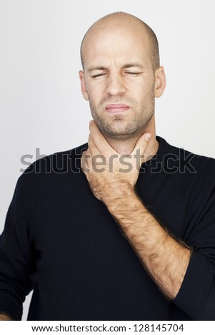Man suffering from throat problems - stock photo