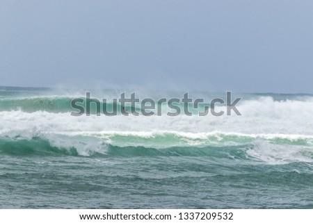 man surfer catching tube barrel wave from Kirra beach Coolangatta Queensland Gold Coast Australia