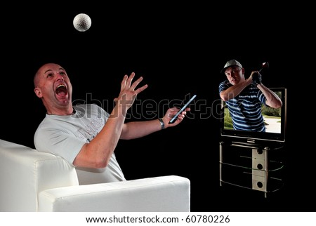 Man surprised at realistic image of golf ball and golfer coming out of 3D TV