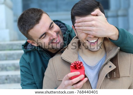 Man surprising his boyfriend with a present #768440401