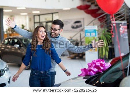 Man surprising his girlfriend with brand new car. #1228215625