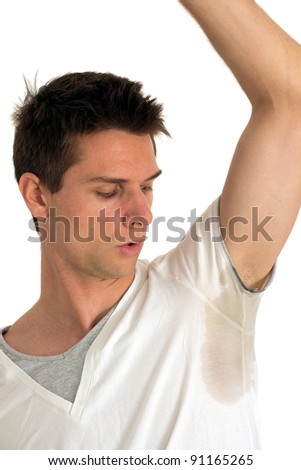 Man sweating very badly under armpit - stock photo