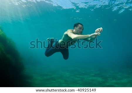 Man swimming in clear water