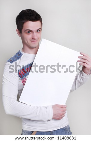 Man takes a placard at white background